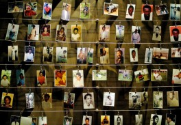 PICTURES OF KILLED PEOPLE ARE INSTALLED ON A WALL INSIDE THE GISOZI MEMORIAL  IN KIGALI